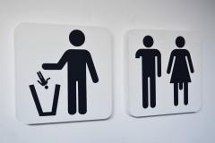 Twee pictogrammen (Gooi jezelf in de afvalbak/ Man en vrouw)